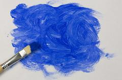 Blue paint with paintbrush Stock Photos