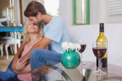 Stock Photo of Cute couple drinking red wine