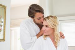 Stock Photo of Cute couple in bathrobes spending time together