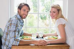 Stock Photo of Cute smiling couple having a meal together