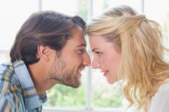 Cute affectionate couple facing each other - stock photo