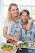 Stock Photo of Cute smiling couple enjoying a meal together