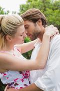 Stock Photo of Cute couple standing outside hugging
