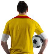 Stock Photo of Football player in yellow holding ball