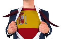 Businessman opening shirt to reveal spain flag Stock Photos