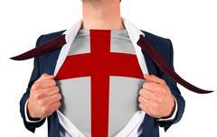 Businessman opening shirt to reveal england flag - stock photo