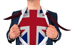 Businessman opening shirt to reveal union jack flag - stock photo