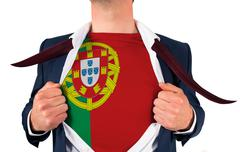 Businessman opening shirt to reveal portugal flag Stock Photos