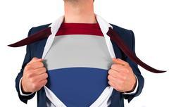 Businessman opening shirt to reveal netherlands flag - stock photo