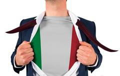 Businessman opening shirt to reveal italy flag - stock photo