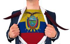 Businessman opening shirt to reveal ecuador flag - stock photo