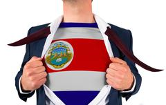 Businessman opening shirt to reveal costa rica flag - stock photo