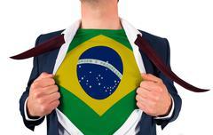 Businessman opening shirt to reveal brasil flag - stock photo