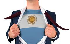 Stock Photo of Businessman opening shirt to reveal argentina flag