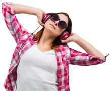 Casual brunette listening to music Stock Photos