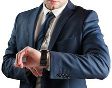 Businessman checking the time on watch - stock photo