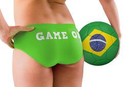 Fit girl holding brasil ball - stock photo