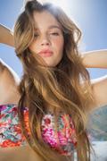 Stock Photo of Beautiful blonde in floral bikini on the beach