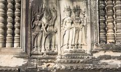 bas-relief on the walls of the angkor watt - stock photo