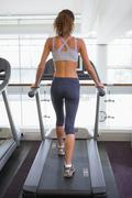 Fit woman walking on the treadmill - stock photo