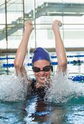 Excited swimmer cheering in the swimming pool Kuvituskuvat