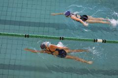Stock Photo of Female swimmers racing in the swimming pool
