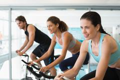 Fit people in a spin class Stock Photos