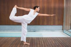 Content brunette in white in the shiva posture Stock Photos