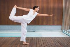 Stock Photo of Content brunette in white in the shiva posture