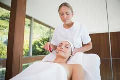 Stock Photo of Peaceful brunette getting micro dermabrasion