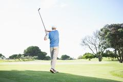 Concentrating golfer taking a shot - stock photo