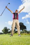 Stock Photo of Excited golfer cheering and looking at camera