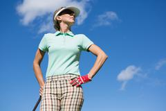 Female golfer standing with hand on hip Kuvituskuvat