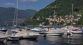 Italy, lake Como,  boats and yachts moored to pier. Footage