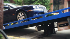 Car Gets Loaded onto a Tow Truck Stock Footage