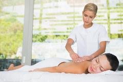 Stock Photo of Content brunette getting a back massage