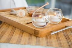 Candles and beauty treatment on tray Stock Photos