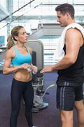 Bodybuilding man and woman talking together Stock Photos