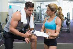 Stock Photo of Bodybuilder talking with his personal trainer