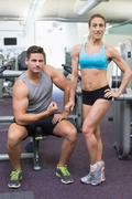 Bodybuilding man and woman posing for the camera Stock Photos