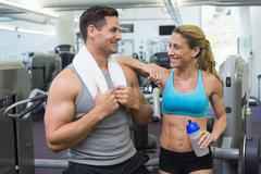 Bodybuilding man and woman chatting together Stock Photos