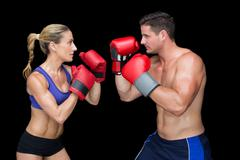 Bodybuilding couple posing with boxing gloves Stock Photos