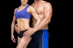 Fit bodybuilding couple posing together Stock Photos