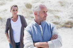 Couple not talking after argument on the beach Stock Photos