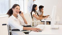 Casual businesswoman in wheelchair on the phone smiling at camera Stock Photos