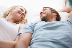 Stock Photo of Cute couple lying on a bed