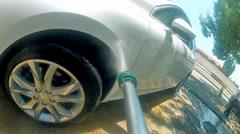 Car pressure jet washing pov Stock Footage