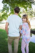 Stock Photo of Cute couple walking in the park