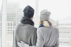 Cute couple in warm clothing - stock photo