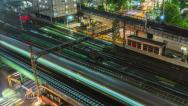 Stock Video Footage of Colorful Trains and Traffic Night Time Lapse 4K